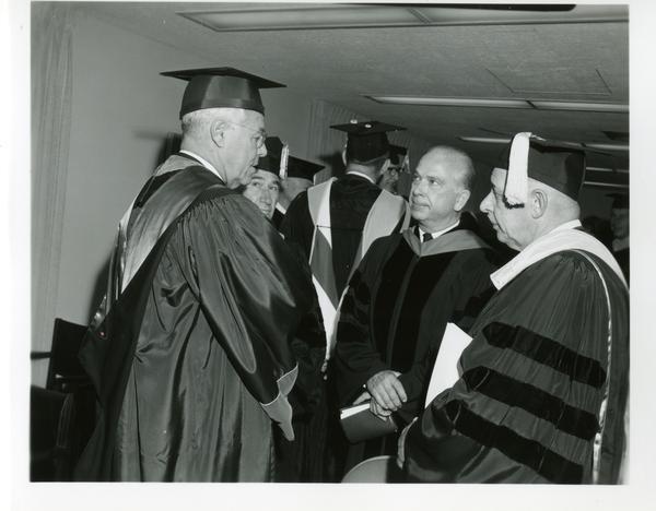 Unidentified men talking at Commencement, June 9, 1966