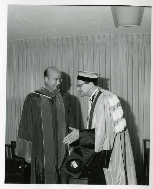 President Clark Kerr with unidentified man at Commencement, June 9, 1966
