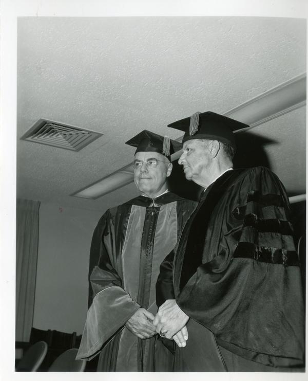 Faculty members posing for a picture at Commencement, June 9, 1966