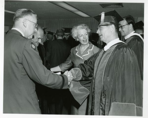 Faculty members shaking hands at Commencement, June 9, 1966