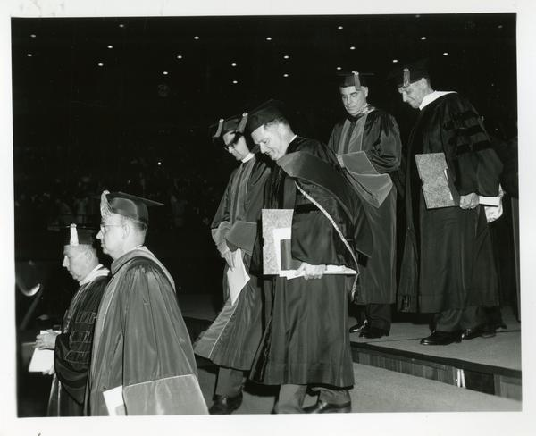 Faculty and administration members walking to stage at Commencement, June 9, 1966