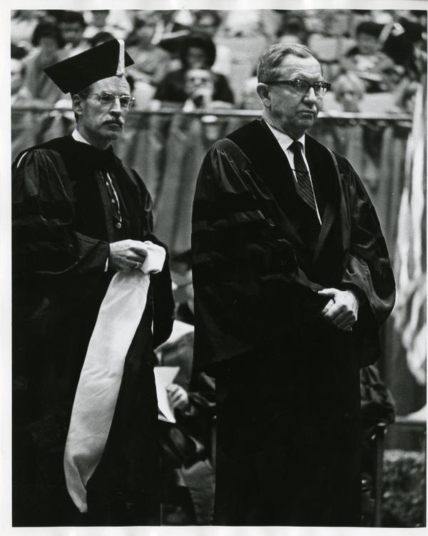 Louis Booker Wright and Robert Vosper walking on stage at Commencement, June, 1967