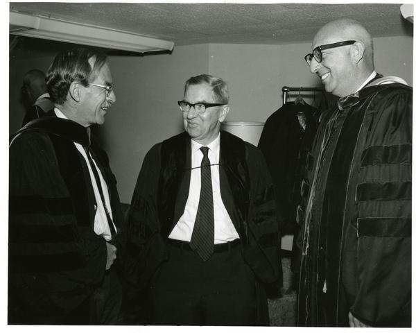 Louis Booker Wright, Robert Vosper and another man talking at Commencement, June, 1967