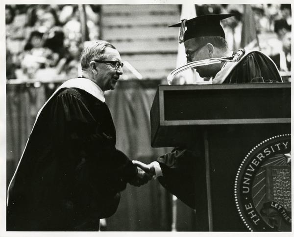 Louis Booker Wright shaking hands with President Kerr at Commencement, June 1967