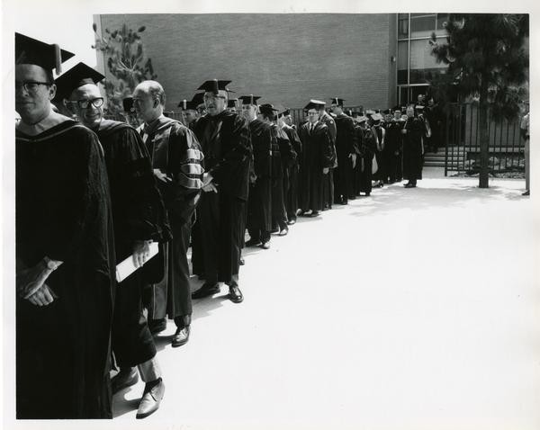 Faculty and administration lining up for Commencement, June 14, 1968