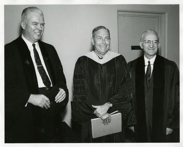 Honorary award recipient with two unidentified men at Commencement, June 14, 1968