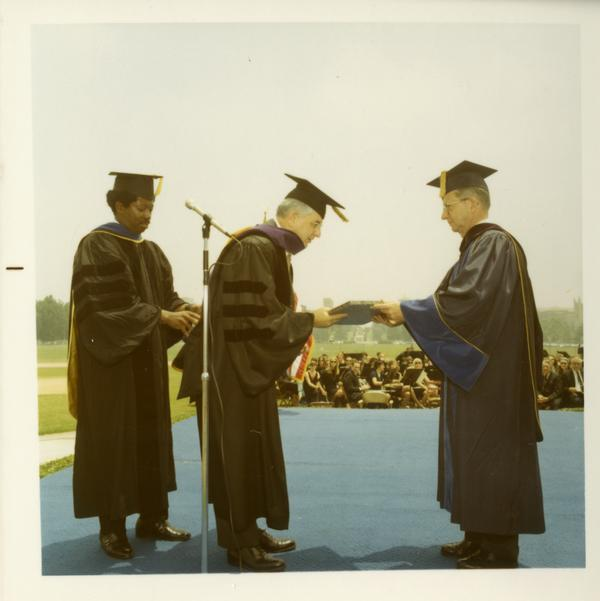 Man receiving his honorary degree at commencement, June 17, 1970