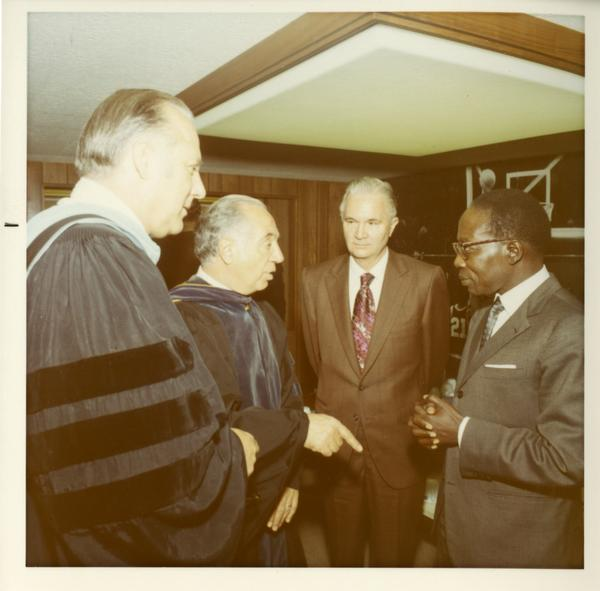 Commencement participants talking at Commencement, 1971