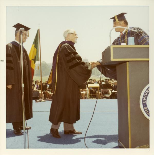 Honorary award recipients shake hands with man on stage, 1971