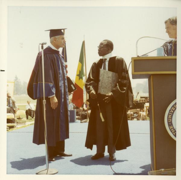 Man receiving his honorary degree at commencement, 1971