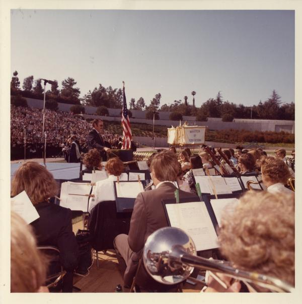 Robert Winslow directing the band at commencement, 1973