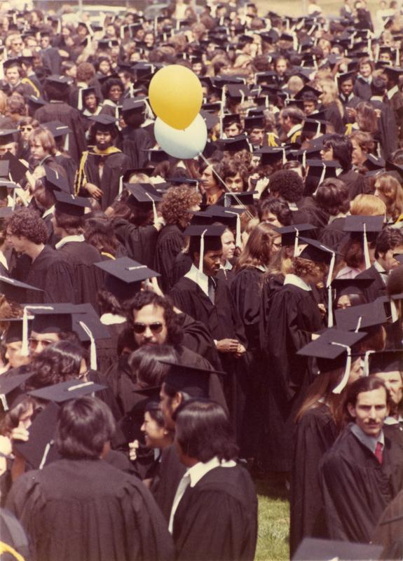Crowds of graduates at commencement, 1975