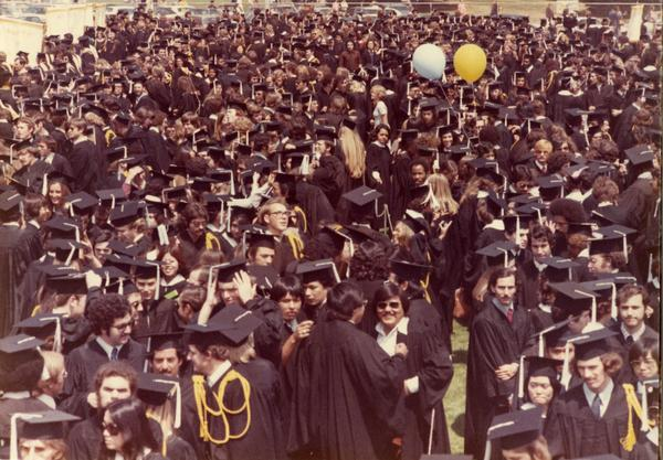 Graduates filing out at commencement, 1975