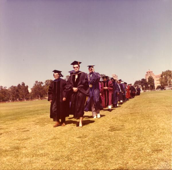 Graduates filing in for commencement, June 1976