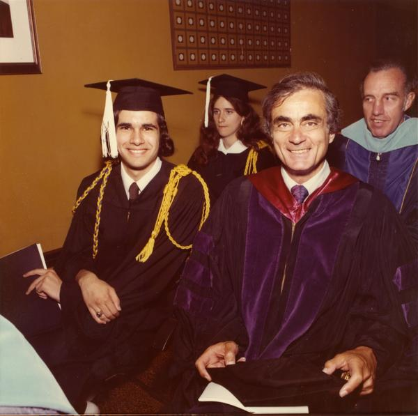 Graduates and faculty members in the robing room waiting for commencement, June 1976