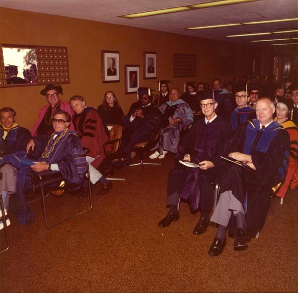 Members of the platform party waiting in the robing room, June 1976