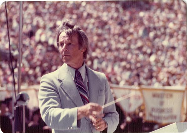 Conductor Kenneth Snapp instructing the band at commencement, June 1976