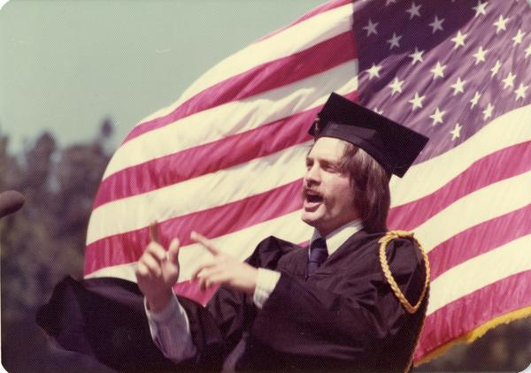 James Richard Hopfenbeck, the song leader, addresses the crowd at commencement, June 1976