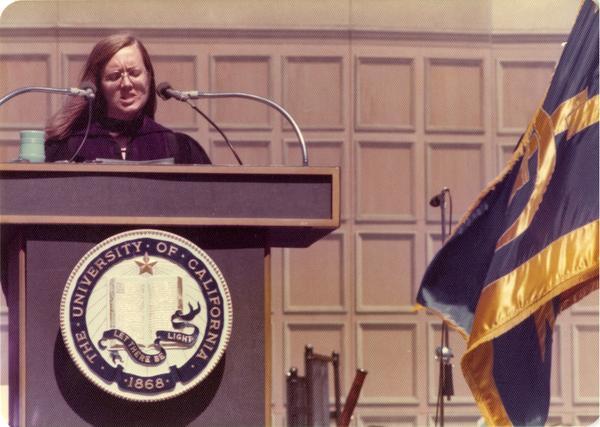 Darlene Walsh, graduate student speaker, addresses the crowds at commencement, June 1976