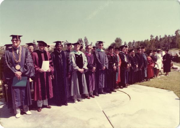 Platform party lined up for commencement, June 1976