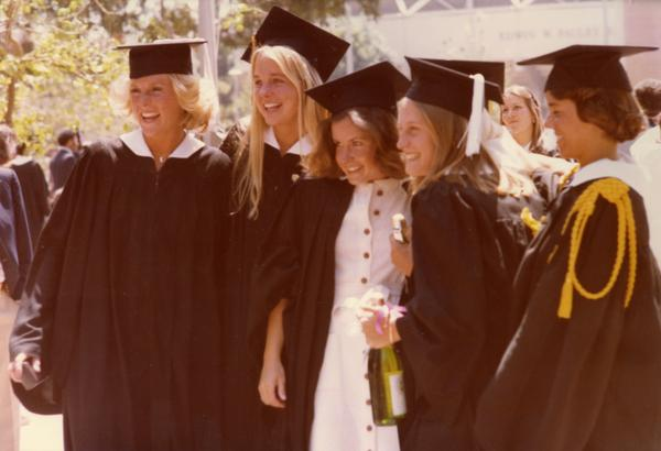 Graduates posing for a camera at commencement, June 1977