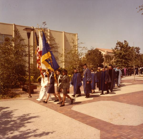 Colorguard leading the academic procession at commencement, June 1979