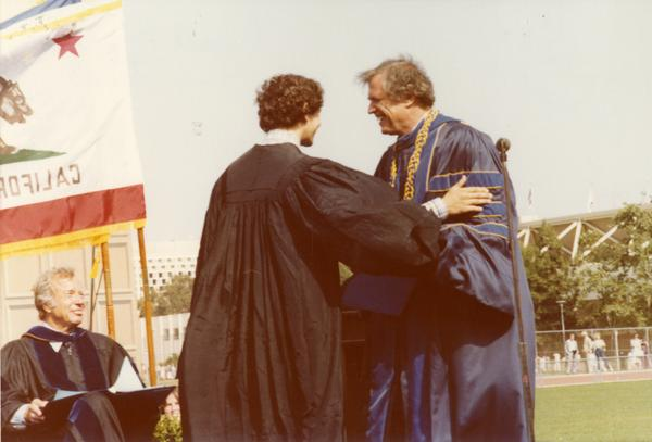 Graduate greets a member of the platform party at commencement, June 1979