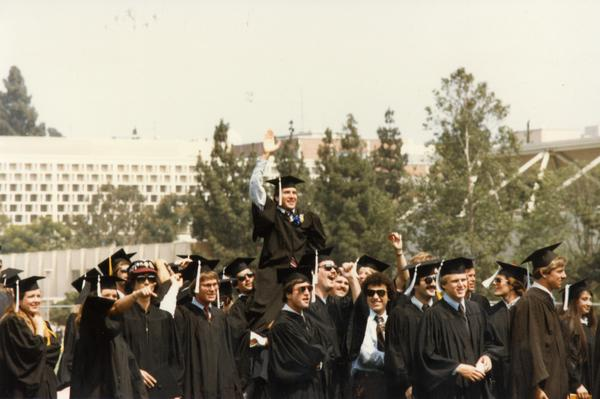 Graduates celebrating at commencement, ca. 1980's