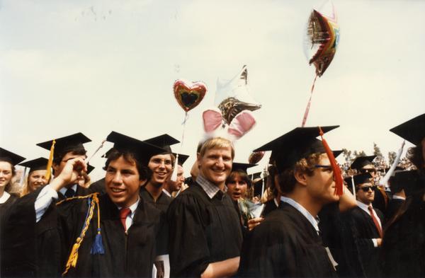 Graduates celebrating at commencement, ca. 1980's