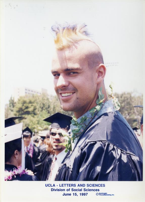 Graduate smiles for the camera at the commencement for the College of Letters and Sciences, Division of Social Sciences, June 15, 1997