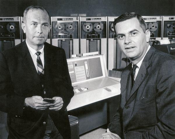 Two workers pose for the camera in the lab at the Western Data Processing Center