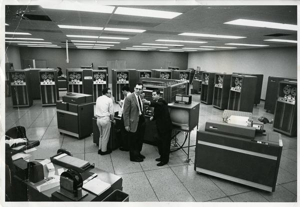 Workers in the lab of the Western Data Processing Center