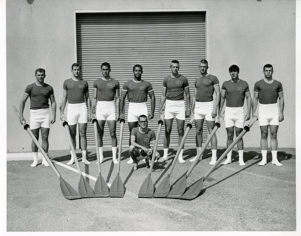 Members of the Crew team holding their rowing equipment