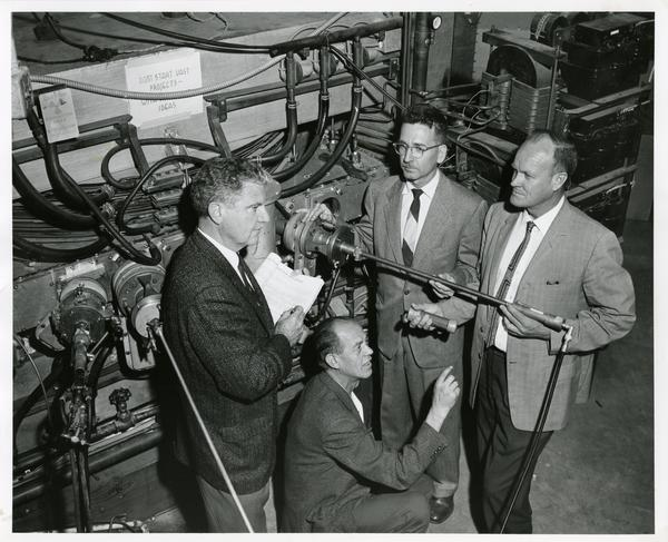 UCLA physicists adjusting the probe on the spinal ridge Cyclotron