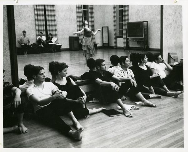 The cast of Theseus and Ariadne watching Carol Smith as the queen in her solo from the Prologue, 1959