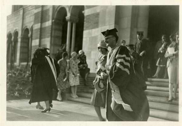 Guests walking down the steps of Royce Hall during the dedication of the Westwood campus, March 1930