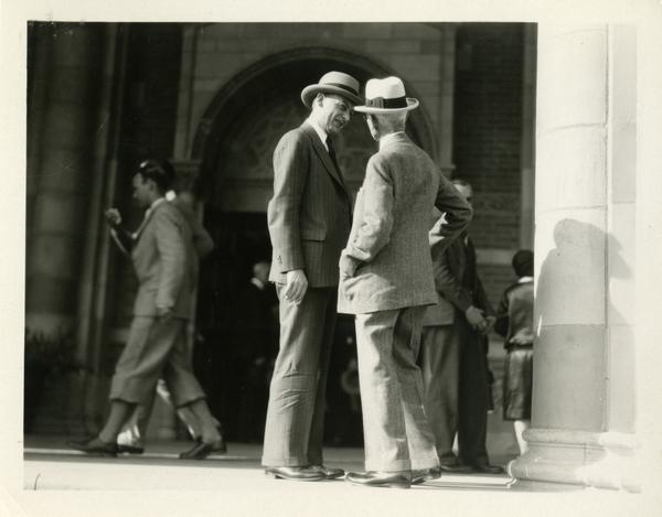Robert Gordon Sproul talking with an unidentified guest on the steps of Royce Hall at the dedication of the Westwood campus, March 1930