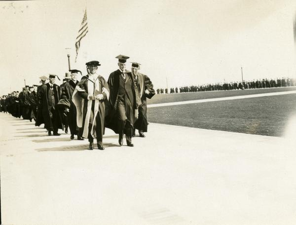 Academic procession heading towards Royce Hall for the dedication of the Westwood campus, March 1930