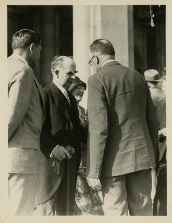 UC President William Wallace Campbell, Provost Ernest Carroll Moore, and unidentified man on the steps of Royce Hall at the dedication of the Westwood campus, March 1930