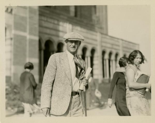 Unidentified guest exiting Royce Hall at the dedication of the Westwood campus, March 1930