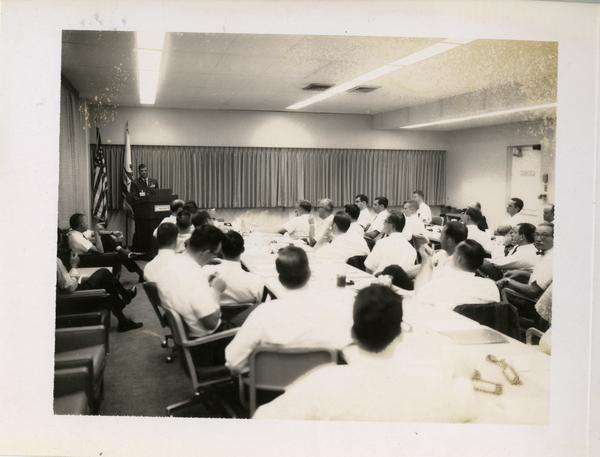 Members of the Defense Science Seminar listening to a speaker, ca. 1965