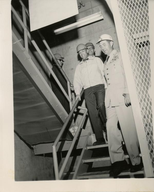 Members of the Defense Science Seminar walking down the stairs, ca. 1965