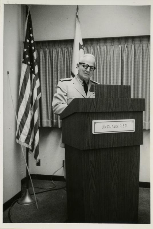 Vice Admiral C. Martel addressing the Defense Science Seminar, ca. 1965