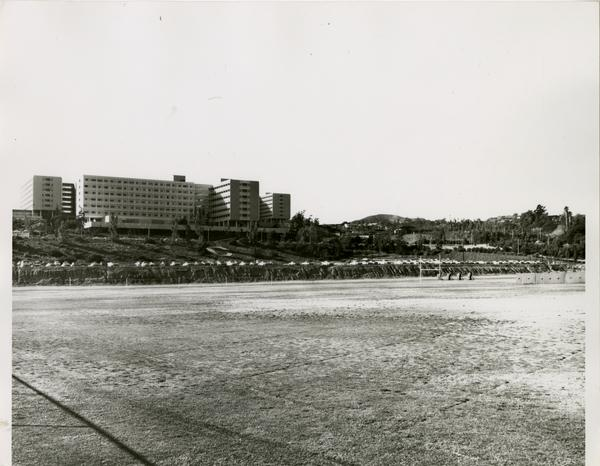 View of Drake stadium from field, looking towards campus dorms