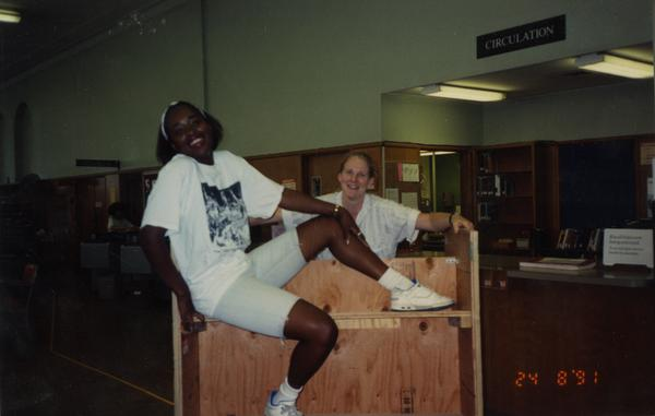 Student assistant and Maria Collins working on dismantling the Education/Psychology Library, 1991