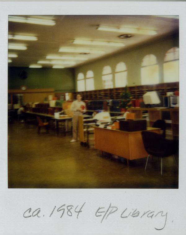 Unidentified man standing in the Education/Psychology Library during the 1984 move