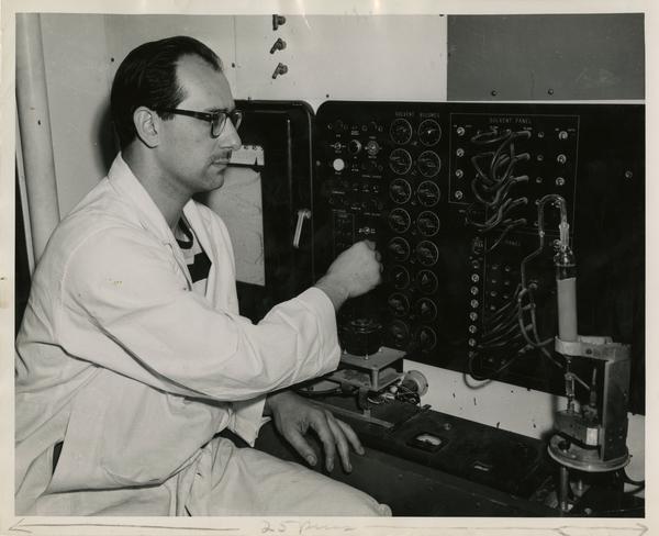 Man adjusting equipment in engineering lab