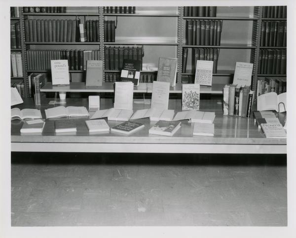 Books set out for display on table in English Reading Room for an UCLA Open House