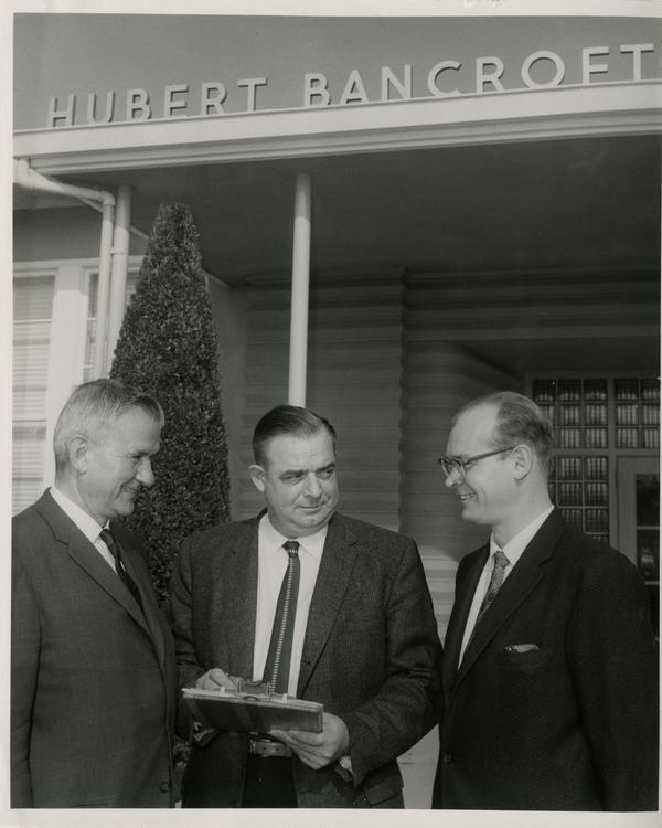 Harold L. Tallman, Carl Ehmann and Dr. Richard N. Baisden stand outside the Hubert Bancroft School