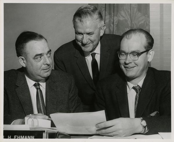 Harold L. Tallman, Carl Ehmann and Dr. Richard N. Baisden discuss plans for the expansion of classes to be held at Bancroft School
